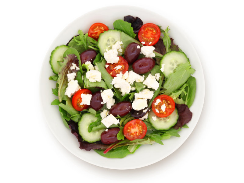 Plate of feta salad with vegetables making up the colours of the rainbow