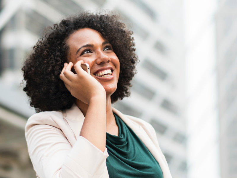 Happy girl speaking on mobile phone